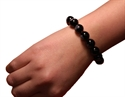 Bild von Schwarzes Glas-Armband mit Buddha und Lotus Aufdruck